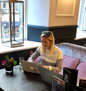 Julia working on her event planning blog,